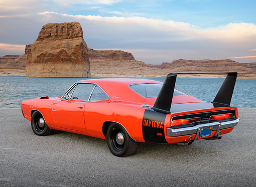 AUT 22 RK3483 01 © Kimball Stock 1969 Dodge Charger Daytona Hemi Orange 3/4 Rear View On Gravel By Water And Red Rock