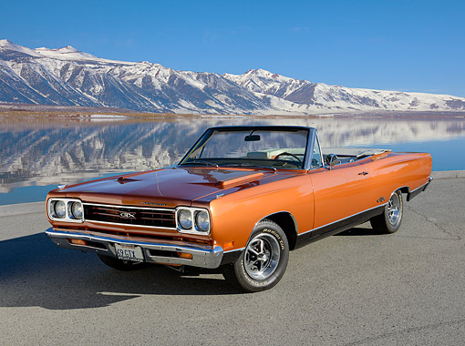 AUT 22 RK3487 01 © Kimball Stock 1969 Plymouth GTX Convertible Metallic Fire Bronze 3/4 Front View On Pavement By Lake And Mountains