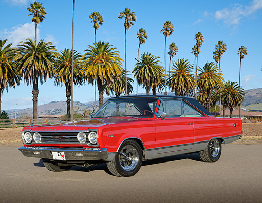 AUT 22 RK3489 01 © Kimball Stock 1967 Plymouth GTX Sport Satellite Red 3/4 Front View On Pavement By Palm Trees