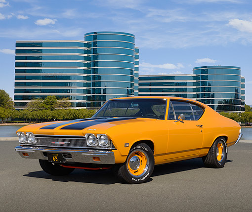 AUT 22 RK3497 01 © Kimball Stock 1968 Chevrolet Chevelle Orange With Black Stripes 3/4 Front View On Pavement By Glass Buildings