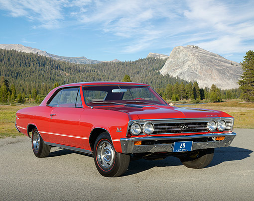 AUT 22 RK3500 01 © Kimball Stock 1967 Chevrolet Chevelle SS 396 Red 3/4 Front View On Pavement In Mountains