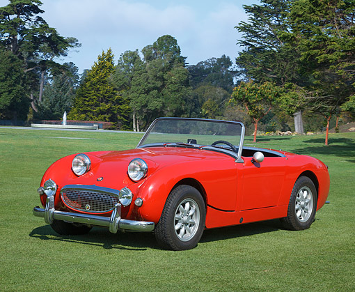 AUT 22 RK3504 01 © Kimball Stock 1960 Austin-Healey Bugeye Sprite Red 3/4 Front View On Grass By Trees
