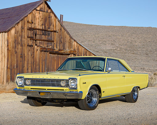 AUT 22 RK3510 01 © Kimball Stock 1966 Plymouth Hemi Satellite Yellow 3/4 Front View On Gravel By Wooden Shed