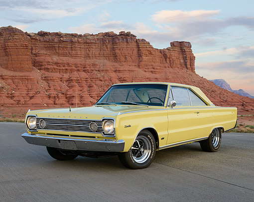 AUT 22 RK3511 01 © Kimball Stock 1966 Plymouth Hemi Satellite Yellow 3/4 Front View On Pavement In Desert