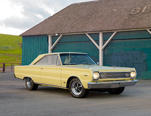 AUT 22 RK3512 01 © Kimball Stock 1966 Plymouth Hemi Satellite Yellow 3/4 Front View On Pavement By Barn