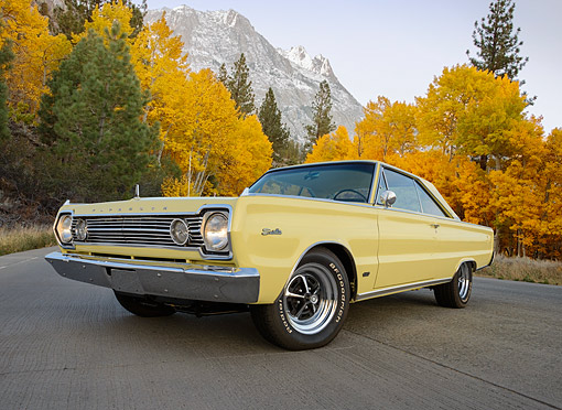 AUT 22 RK3513 01 © Kimball Stock 1966 Plymouth Hemi Satellite Yellow 3/4 Front View On Pavement By Mountains And Autumn Trees