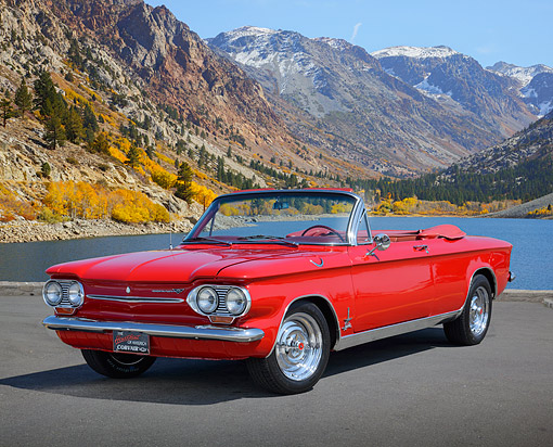 AUT 22 RK3517 01 © Kimball Stock 1963 Corvair Convertible Spyder Red 3/4 Front View On Pavement By Lake And Mountains