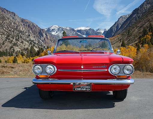 AUT 22 RK3518 01 © Kimball Stock 1963 Corvair Convertible Spyder Red Front View On Pavement By Mountains