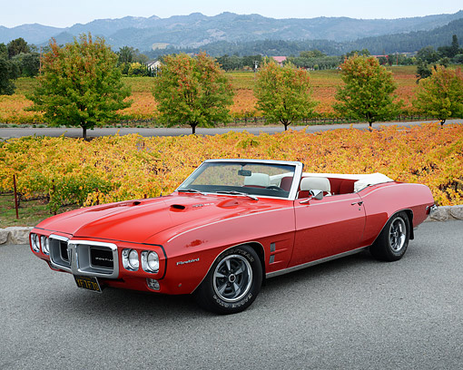 AUT 22 RK3519 01 © Kimball Stock 1969 Pontiac Firebird 400 Ram Air Red Front View On Pavement By Autumn Vineyard