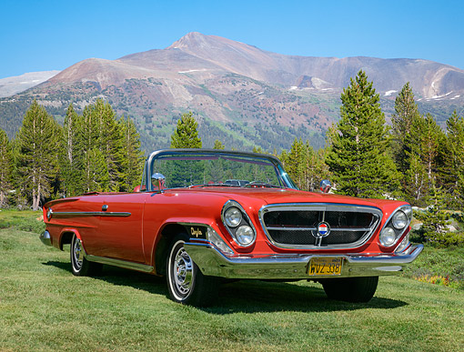 AUT 22 RK3521 01 © Kimball Stock 1962 Chrysler 300 Convertible Red 3/4 Front View On Grass By Mountains