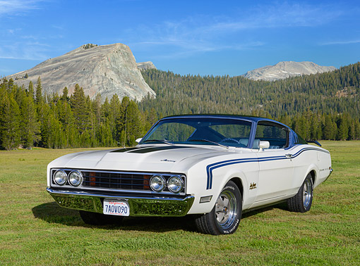 AUT 22 RK3523 01 © Kimball Stock 1969 Mercury Cyclone Spoiler II Dan Gurney Special Blue And White 3/4 Front View On Grass By Mountains
