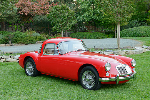 AUT 22 RK3525 01 © Kimball Stock 1960 MGA Coupe Chariot Red 3/4 Front View On Grass By Trees
