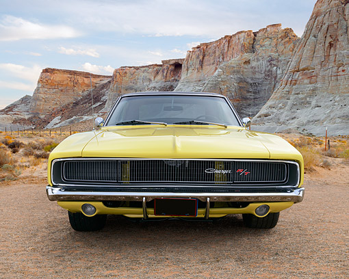 AUT 22 RK3530 01 © Kimball Stock 1968 Dodge Charger R/T Yellow Front View On Gravel In Desert
