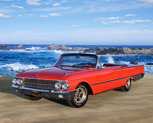AUT 22 RK3532 01 © Kimball Stock 1961 Ford Galaxie Sunliner Red 3/4 Front View On Sand By Ocean