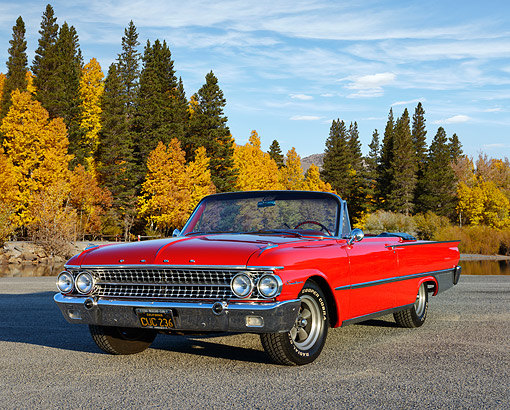 AUT 22 RK3533 01 © Kimball Stock 1961 Ford Galaxie Sunliner Red 3/4 Front View On Pavement By Autumn Trees