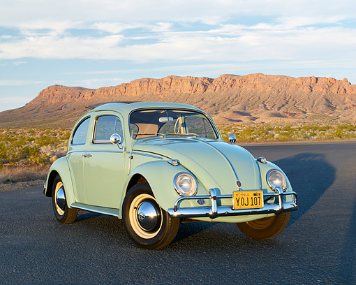 AUT 22 RK3539 01 © Kimball Stock 1961 Volkswagen Beetle Turquoise 3/4 Front View On Pavement In Desert