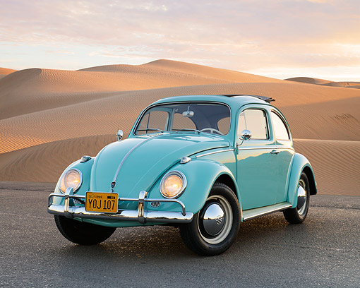 AUT 22 RK3540 01 © Kimball Stock 1961 Volkswagen Beetle Turquoise 3/4 Front View On Pavement By Sand Dunes At Dusk