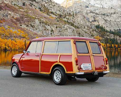 AUT 22 RK3545 01 © Kimball Stock 1967 Austin Mini Woody Red 3/4 Rear View On Pavement By Lake And Mountains