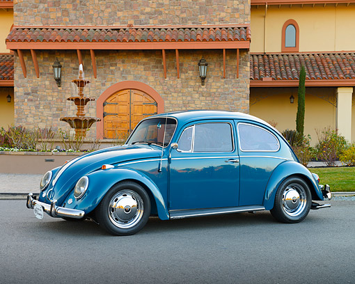 AUT 22 RK3546 01 © Kimball Stock 1966 Volkswagen Beetle Blue 3/4 Side View On Pavement By Fountain
