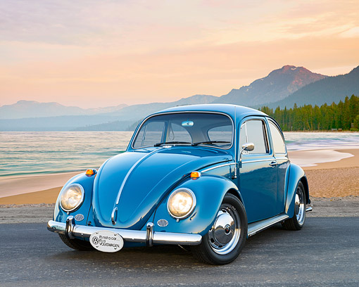 AUT 22 RK3547 01 © Kimball Stock 1966 Volkswagen Beetle Blue 3/4 Front View On Pavement By Beach At Sunset