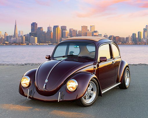 AUT 22 RK3552 01 © Kimball Stock 1968 Volkswagen Bug Burgundy 3/4 Front View On Pavement By City Skyline At Dusk