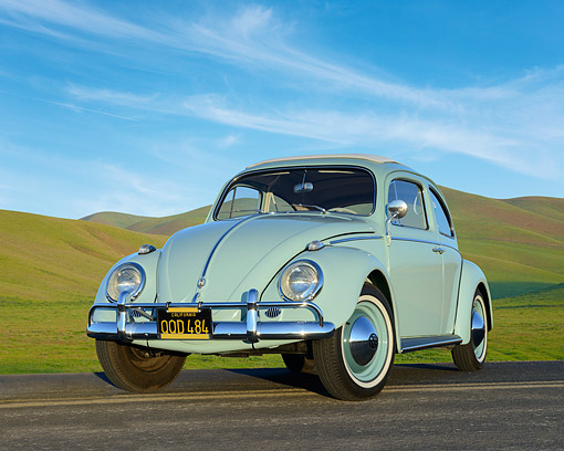 AUT 22 RK3554 01 © Kimball Stock 1961 Volkswagen Bug Sea Foam Green 3/4 Front View On Road By Grassy Hills