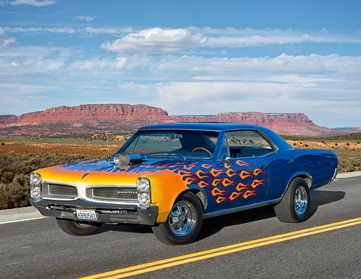 AUT 22 RK3559 01 © Kimball Stock 1966 Pontiac LeMans Blue With Orange Flames 3/4 Front View On Road In Desert