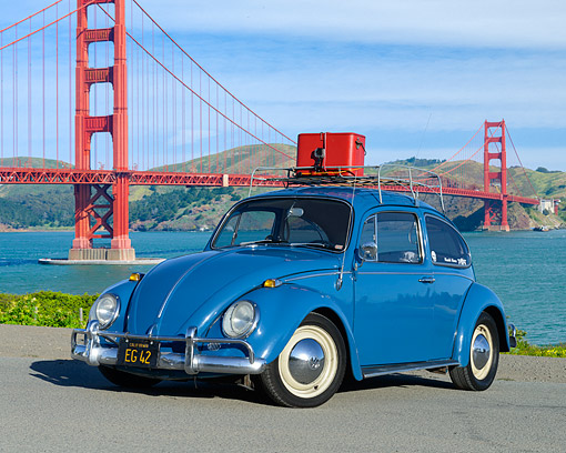 AUT 22 RK3571 01 © Kimball Stock 1966 Volkswagon Beetle Blue 3/4 Front View By Bridge