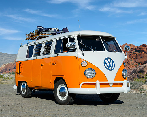 AUT 22 RK3574 01 © Kimball Stock 1967 Volkswagon Bus Split Window Orange And White 3/4 Front View On Pavement