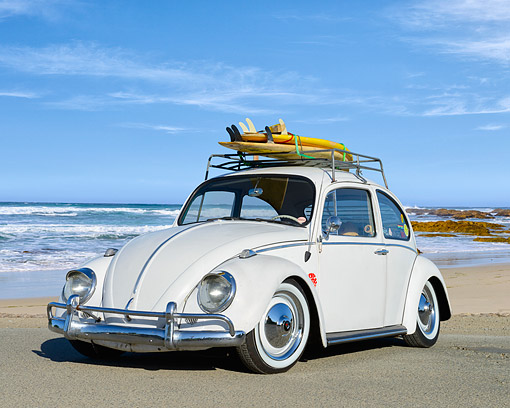 AUT 22 RK3578 01 © Kimball Stock 1969 Volkswagon Beetle White 3/4 Front View On Beach