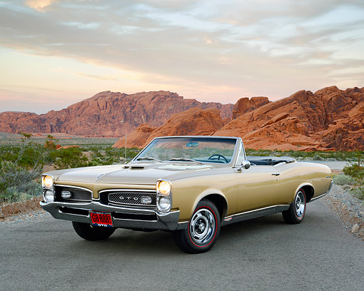 AUT 22 RK3584 01 © Kimball Stock 1967 Pontiac GTO Convertible Gold On Pavement