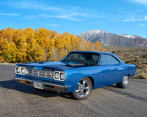 AUT 22 RK3604 01 © Kimball Stock 1968 Plymouth Road Runner Blue 3/4 Front View On Pavement By Mountain