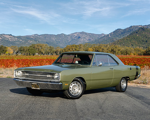 AUT 22 RK3607 01 © Kimball Stock 1969 Dodge Dart Green 3/4 Front View On Pavement By Vineyard