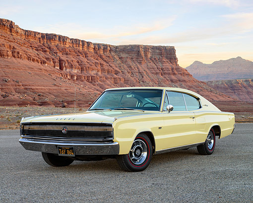 AUT 22 RK3610 01 © Kimball Stock 1967 Dodge Charger 383 Yellow 3/4 Front View On Pavement On Lonely Desert Highway