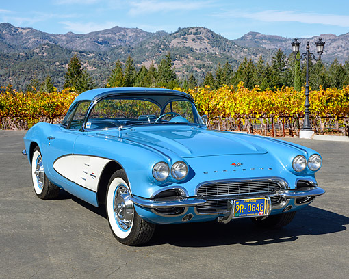 AUT 22 RK3612 01 © Kimball Stock 1961 Chevrolet Jewel Blue And Cream White 3/4 Front View In Vineyard