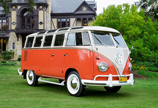 AUT 22 RK3617 01 © Kimball Stock 1961 Volkswagon Bus Orange 3/4 Front View On Grass By Mansion