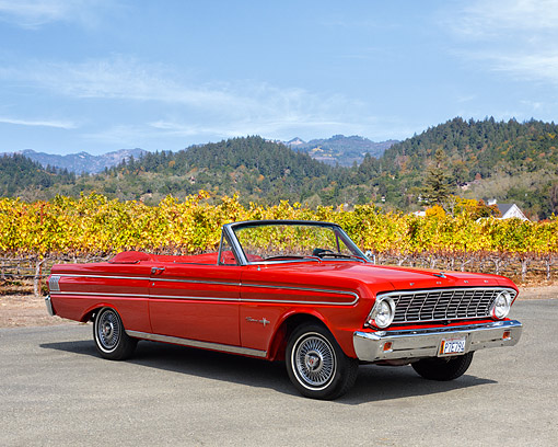 AUT 22 RK3620 01 © Kimball Stock 1964 Ford Falcon Sprint Convertible Red 3/4 Front View On Pavement By Vineyard