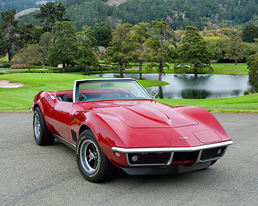 AUT 22 RK3627 01 © Kimball Stock 1968 Chevrolet Corvette Roadster Red 3/4 Front View Chilling On Golf Course