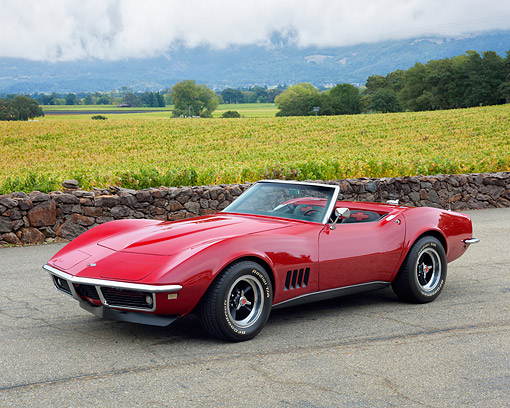AUT 22 RK3628 01 © Kimball Stock 1968 Chevrolet Corvette Roadster Red Side View In Vineyard
