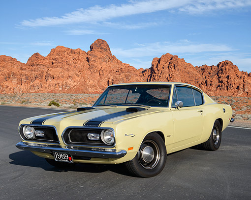 AUT 22 RK3631 01 © Kimball Stock 1969 Plymouth Barracuda Yellow 3/4 Front View In Desert