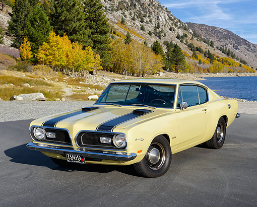 AUT 22 RK3632 01 © Kimball Stock 1969 Plymouth Barracuda Yellow 3/4 Front View By Mountain Lake