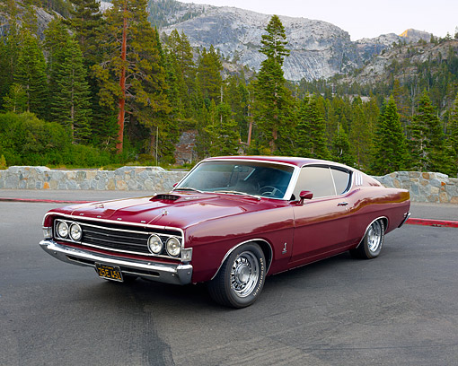 AUT 22 RK3633 01 © Kimball Stock 1969 Ford Torino 428 Cobra Jet Maroon 3/4 Front View In Forest