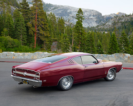 AUT 22 RK3634 01 © Kimball Stock 1969 Ford Torino 428 Cobra Jet Maroon 3/4 Rear View In Forest