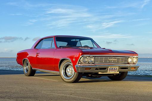 AUT 22 RK3640 01 © Kimball Stock 1966 Chevrolet Chevelle Malibu Red 3/4 Front View By The Bay