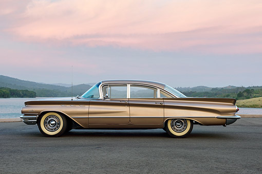 AUT 22 RK3645 01 © Kimball Stock 1960 Buick LeSabre Tahitian Beige Profile View By Lake