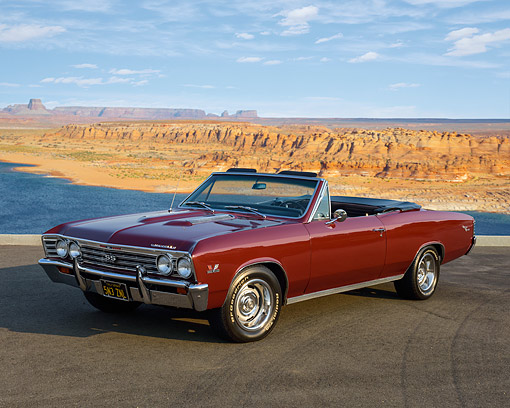 AUT 22 RK3646 01 © Kimball Stock 1967 Chevrolet Chevelle SS 396 Convertible Maroon 3/4 Front View On Pavement In Desert