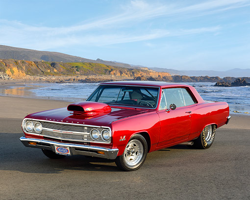 AUT 22 RK3648 01 © Kimball Stock 1965 Chevrolet SS Red 3/4 Front View On Beach