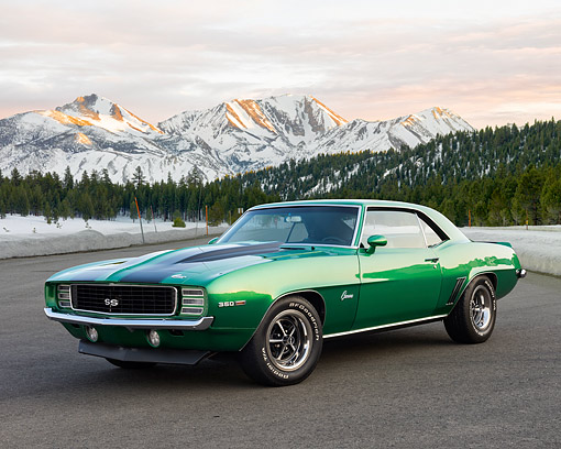 AUT 22 RK3659 01 © Kimball Stock 1969 Chevrolet Camaro SS 350 Rally Green 3/4 Front View On Pavement In Snowy Forest