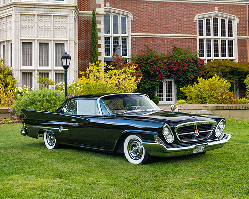 AUT 22 RK3665 01 © Kimball Stock 1961 Chrysler 300 G Black 3/4 Front View On Grass By Building