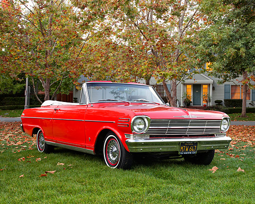 AUT 22 RK3667 01 © Kimball Stock 1962 Chevrolet Nova Convertible Red 3/4 Front View On Grass By House